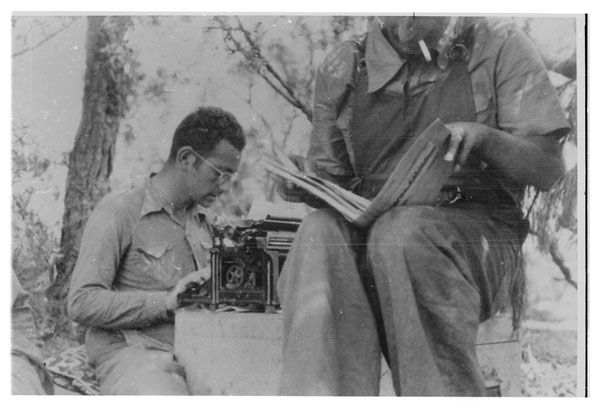 Members of the Mackenzie-Papineau Battalion writing and reading.