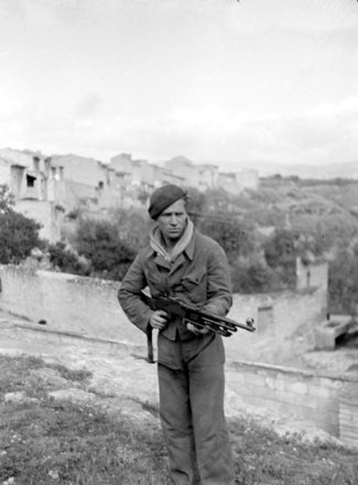Stanley Vernon in uniform holding a gun
